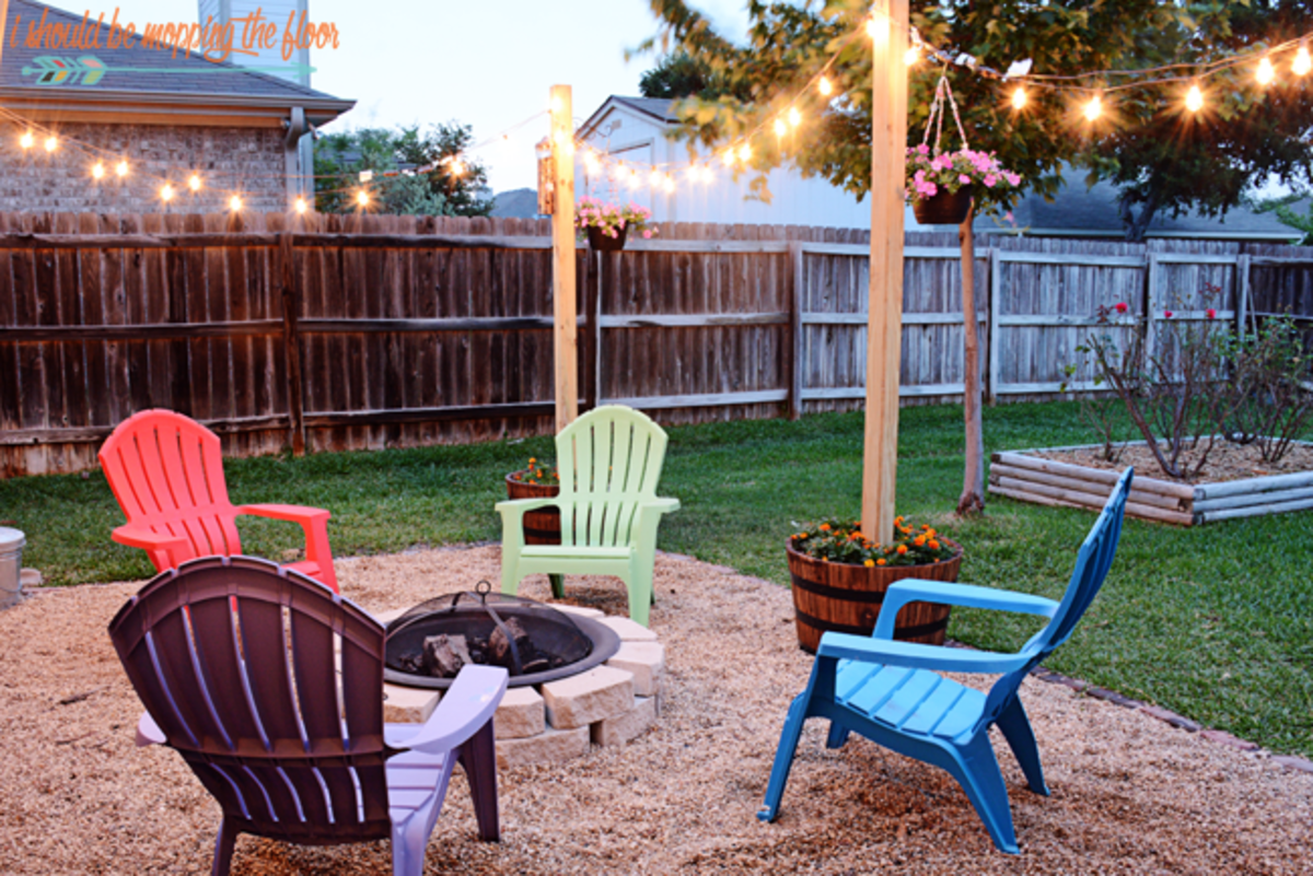DIY Patio Area With Texas Lamp Posts from ishouldbemoppingthefloor.com