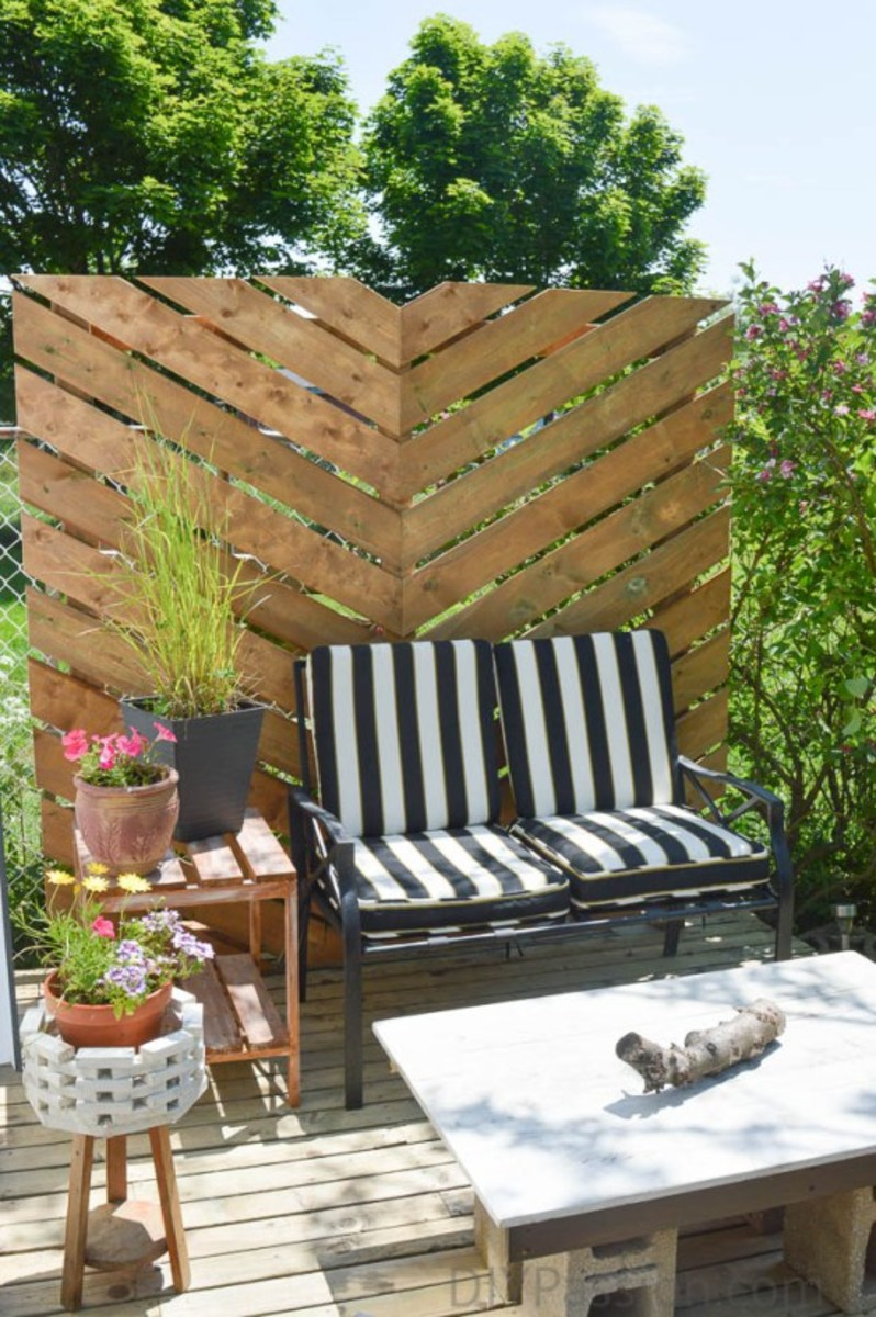 How To Build A Simple Chevron Outdoor Privacy Wall from diypassion.com