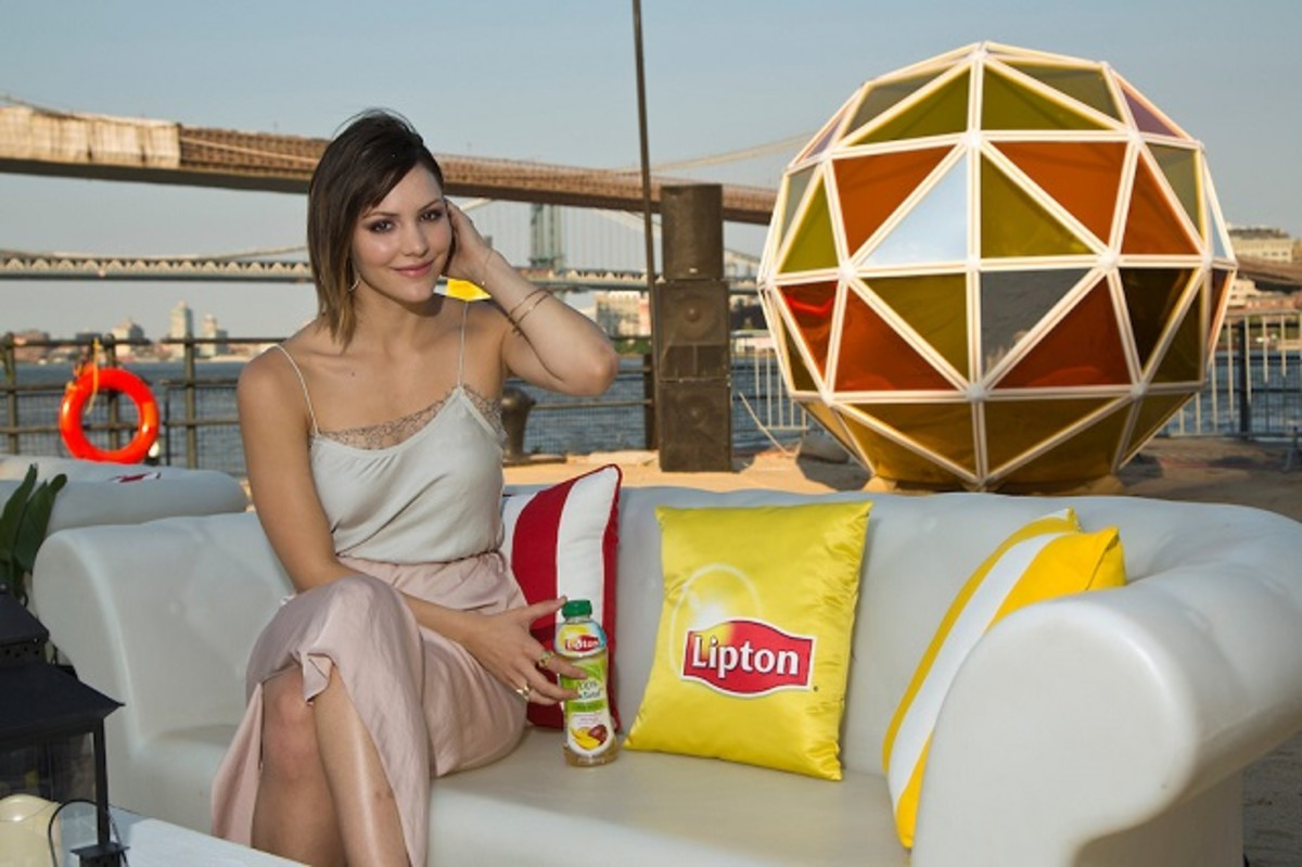 "Singer Katharine McPhee ushers in this year's summer solstice by lighting the ""Lipton Sun"" at the Summer TASTE Party in New York"