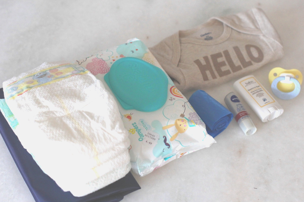 Diaper bag essentials including Pampers, a change of clothes from Gerber, and diaper rash relief.